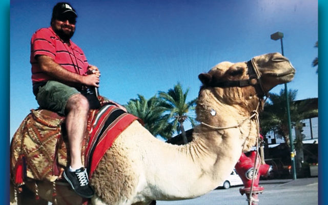 Matthew Nieporent of Westwood prepares to ride a camel during a previous trip to Israel. His suggestion led to the first Israel4All Special Needs Trip.