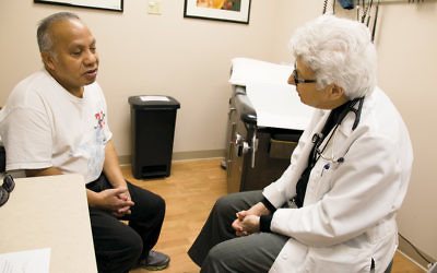 Dr. Charlotte Sokol with a patient, John. (Courtesy BVMI)