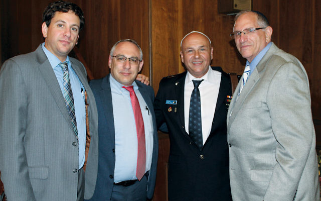 From left, Eric Mark, Vice Consul Amir Sagie, Commander Yitzchak Almog, and Rabbi Bob Mark at the Clifton Jewish Center. (Rabbi Bob Mark)