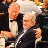Robert Bardach, assistant vice president of the Jewish Home Family, left, and Harold Cohn, a resident of the Jewish Home at Rockleigh.