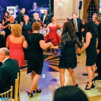 Guests enjoy dancing a hora.