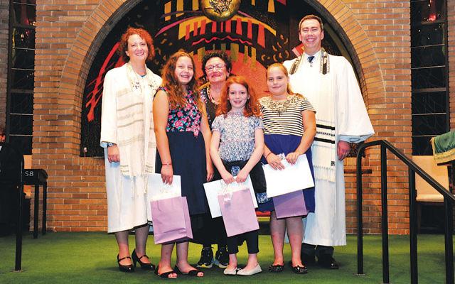 Cantor Ellen Tilem, Dora Geld Friedman, and Rabbi Steven Sirbu join students at the consecration ceremony. (Barbara Balkin)