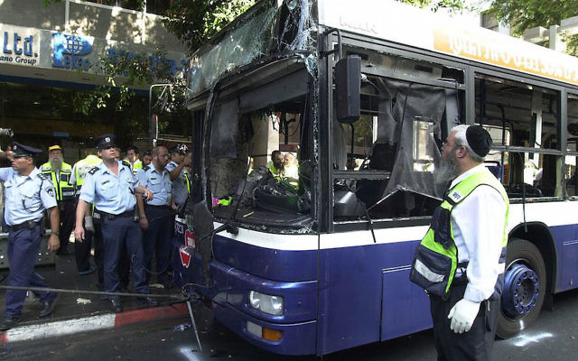 Israeli police and aid workers searching the scene of a suicide bomb attack on a bus in Tel Aviv, Sept. 19, 2002. (Rahanan Cohen/IDF/Getty Images)