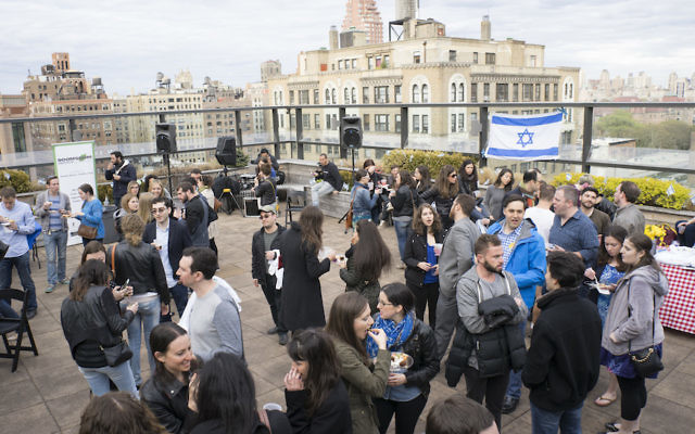Participants in a past Shavuot program at JCC Manhattan gather on the JCC's roof. (Courtesy of JCC Manhattan)