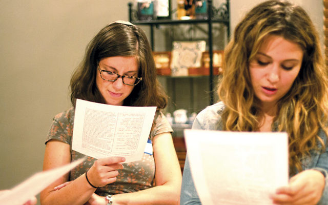 Young leaders study Torah from source sheets at a Hillel International convention. (Hillel International)