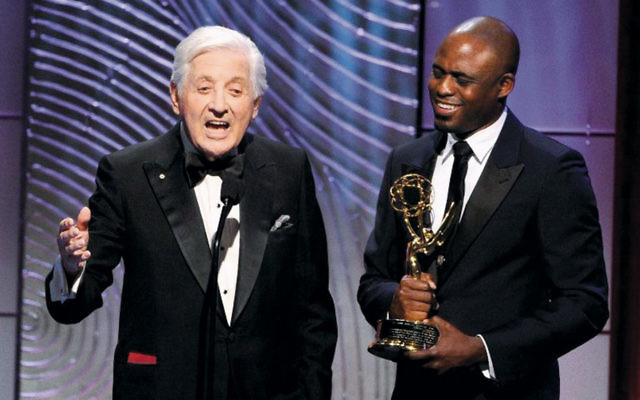 "Monty Hall receives the Lifetime Achievement Award during the 40th Annual Daytime Emmy Awards on June 16, 2013. The presenter is Wayne Brady, his successor as host of ""Let's Make a Deal."" (Kevin Winter/Getty Images)"