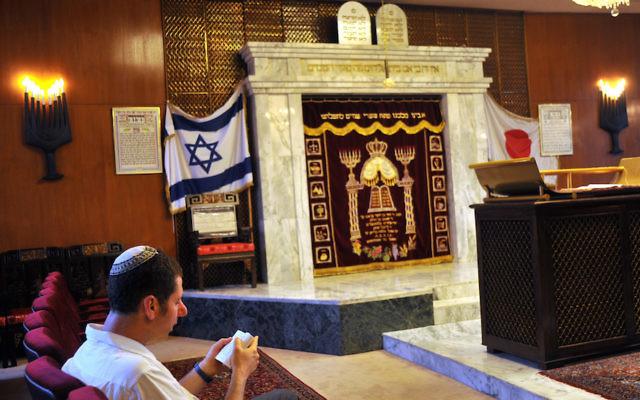 A man praying at the the century-old Ohel Shelomoh Synagogue in Kobe, Japan, June 26, 2009. (Serge Attal/Flash90)