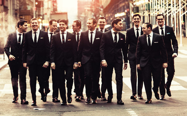 Members of the Maccabeats head down a Manhattan street in perfect harmony.