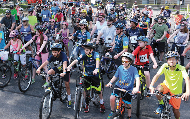 Children and adults line up for the start of the 2016 Wheels for Meals Ride to Fight Hunger.