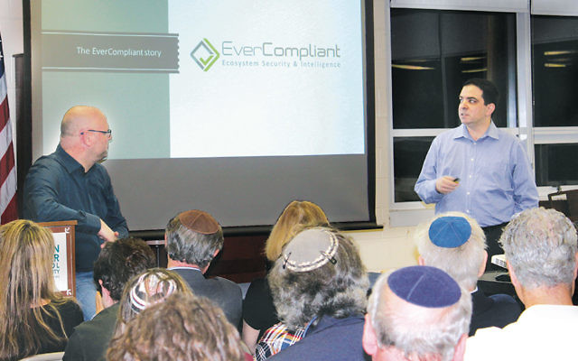 Gil Eyal, left, and Ron Teicher describe the Israel startup scene to parents of Solomon Schechter Day School students.