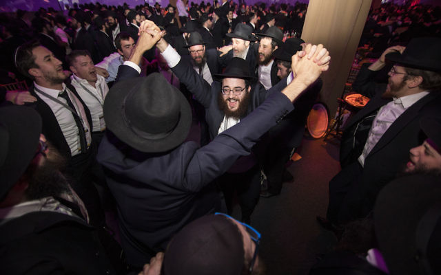 Chabad-Lubavitch rabbis dancing at the movement's annual conference in Bayonne, N.J., Nov. 19, 2017. (Mendel Grossbaum/Chabad.org)