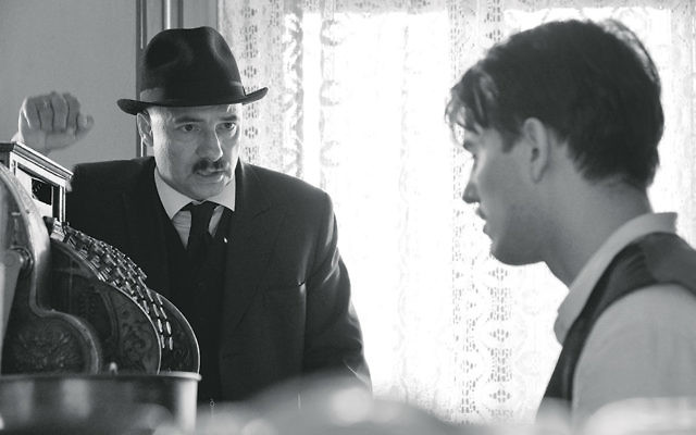Peter Rudolf, left, portrays one of two Jews who returns to a Hungarian village after the war.