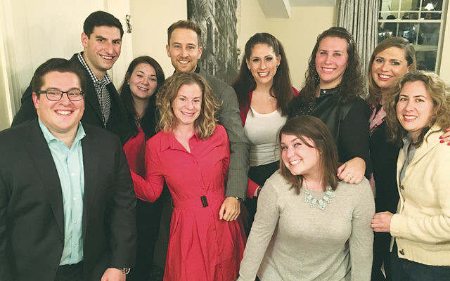 Shabbat dinner hosts Michael Chananie, left, and his wife, Alyson, second from right, stand with some of the other young professionals with JNFuture North/Central NJ. Local attendees not pictured included Mike Smith of Paramus, Anna Richlin of Jersey City, and Josh Goodkin of Hoboken.