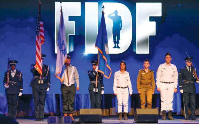 U.S. and Israeli soldiers at the FIDF N.Y. gala. (Photos by Shahar Azran)