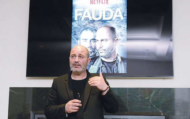 """""""Fauda"""" co-creator and star Lior Raz at a March meeting at the home of FIDF New Jersey co-chairs Jodi and Saul Scherl. (Nir Arieli)"""