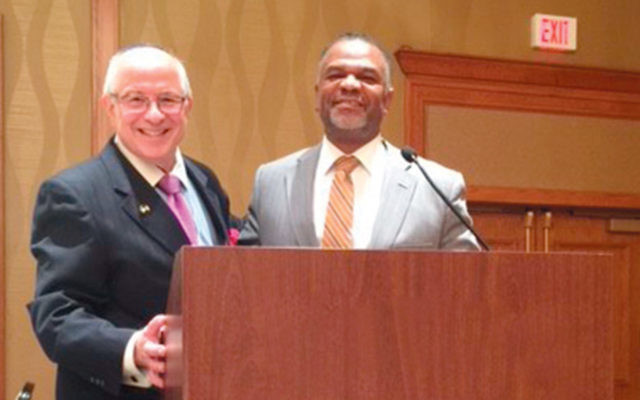Dean Steven Huberman, left, with Dr. Martell Teasley. (Courtesy Touro)