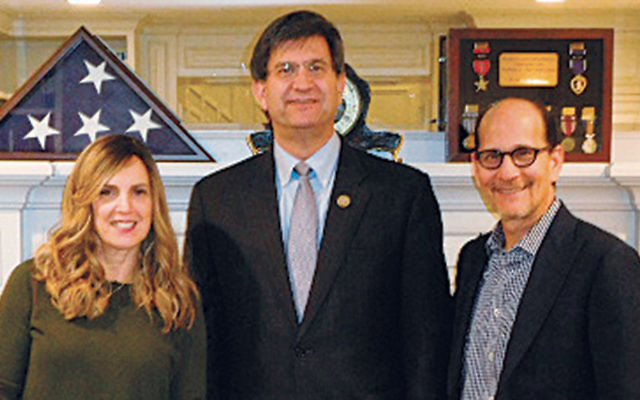 Rochelle Goldschmiedt and her husband, Phil, flank Congressman Brad Schneider. (Courtesy Norpac)