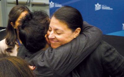 Knesset member Merav Michaeli hugs a participant at the Israeli American Council's annual Washington conference. (Photos by Ron Kampeas)