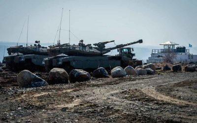 Israeli tanks at the Israel-Syria border on the Golan Heights, Nov. 27, 2016. (Basel Awidat/Flash90)