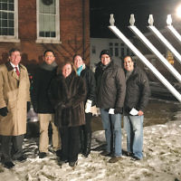 Rabbi Arthur Weiner of the Jewish Community Center of Paramus/Congregation Beth Tikvah, left, joined Oradell's Mayor Dianne Didio, members of the Oradell Council, and Rabbi Paul Jacobson of Temple Avodat Shalom of River Edge in celebrating Chanukah in Oradell.