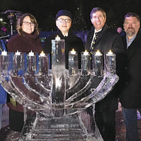 Bergen County Executive Jim Tedesco, left, attended a menorah-lighting ceremony at the Winter Wonderland in Van Saun Park in Paramus on December 16. With him are Bergen Freeholder Tracy Zilna Zur; Cantor Sam Weiss and Rabbi Arthur Weiner, both of the JCC of Paramus/Congregation Beth Tikvah; and Freeholder Tom Sullivan. (bergencountywinterwonderland.com)