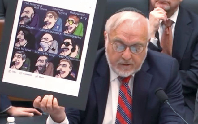 Rabbi Abraham Cooper shows the House Judiciary Committee an anti-Semitic Facebook meme posted by Rutgers Professor Michael Chikindas.