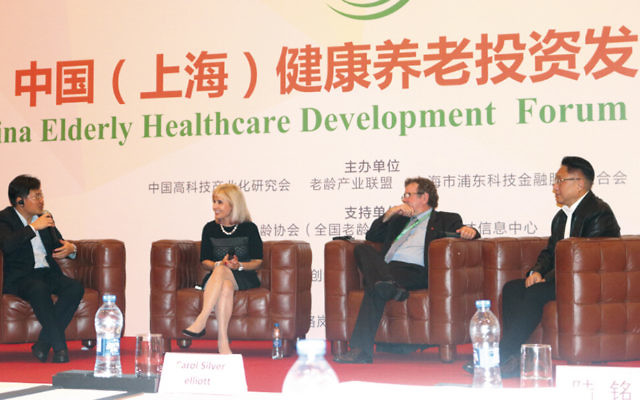 Carol Silver Elliott, president and CEO of the Jewish Home Family, participates in a panel discussion in China on the nation's efforts to provide for its growing number of elderly citizens.