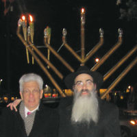 Cresskill's Mayor Benedict Romeo and Lubavitch on the Palisades' Rabbi Mordechai Shain are pictured at the Cresskill Menorah Lighting. LOTP also celebrated Chanukah in Tenafly and Demarest. (Courtesy LOTP)