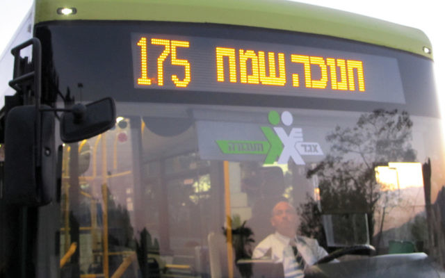 This bus to Ma'aleh Adumim displays a Chanukah greeting. (Jacob Richman)