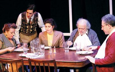 The Berger family around the dinner table. From left, Ronit Asheri-Sandler, Luzer Twersky, Lea Kalisch, David Mandelbaum, and Eli Rosen.