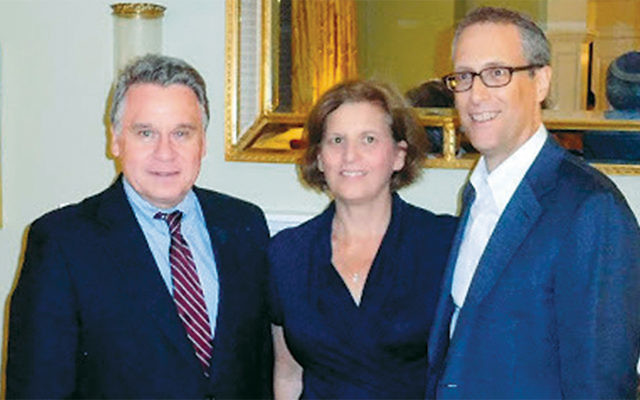 Congressman Smith, left, with Rena and David Schlussel. (Courtesy Norpac)