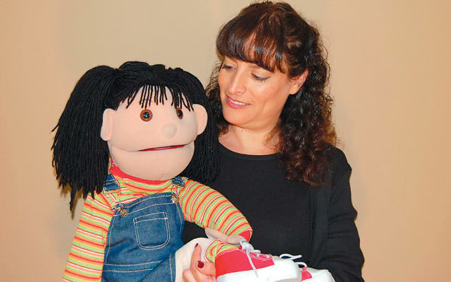Karen Rostoker-Gruber and her puppet, Maria.