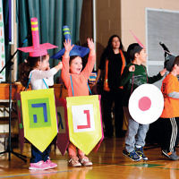 Students at Solomon Schechter Day School of Bergen County in New Milford participated in the annual Chanukah Zimriyah, where each grade performs and participates in the school-wide holiday celebration. (Courtesy SSDS)