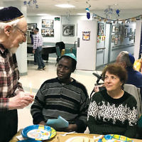 Residents at the Federation Apartments in Paterson celebrated at a Chanukah Chagigha on December 13.  (Photo provided)