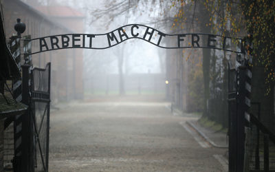 "The main gate of the former Auschwitz extermination camp in Oswiecim, Poland, with the infamous sign reading ""Work sets you free."" (Christopher Furlong/Getty Images)"