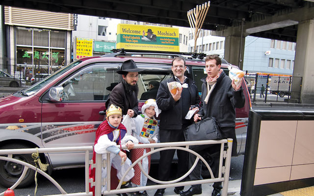 Rabbi Binyomin Edery, left, and some of his congregants in Tokyo in 2009. (Courtesy of Chabad Tokyo Japan)