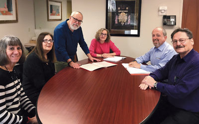 From left, Karen Misler, Joy Sapin, Lee Paskind, Lainie Rosen, Paul Resnick, and Bernie Rous are among the members of Beth Sholom's Tzedek Tirdof committee.