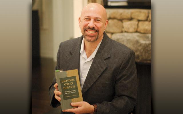Rabbi Schwartz with a book by Rabbi Abraham Joshua Heschel.