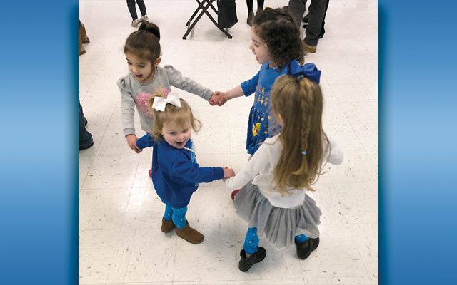 Children dance at the JCC's Chanukah party at the recreation center in Westwood.
