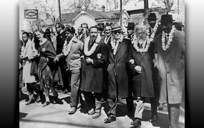 Dr. Martin Luther King, center, is flanked by Rev. Ralph Abernathy, left, Dr. Ralph Bunche, and Rabbi Abraham Joshua Heschel at the 1964 march in Selma, Alabama.