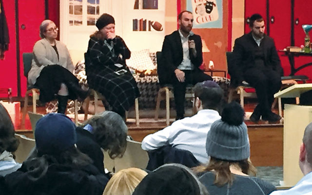 The panel — from left, Dr. Oshra Cohen, Dr. Rayzil Yaish, Dr. Matis Shulman, and Rabbi Scott Friedman — sit in the mock teen bedroom where parents were encouraged to hunt for signs of drug use.