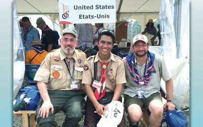 In the International Jamboree in Japan three years ago, an Indonesian scout is flanked by Rabbi Prouser, left, and Archpriest Eric Tosi, national chaplain for Christian Orthodox scouts.