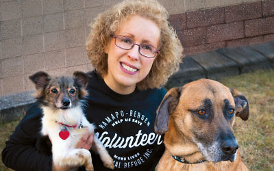 Lyn Ofrane holds Scooter, left, and Harley. Both are available for adoption.