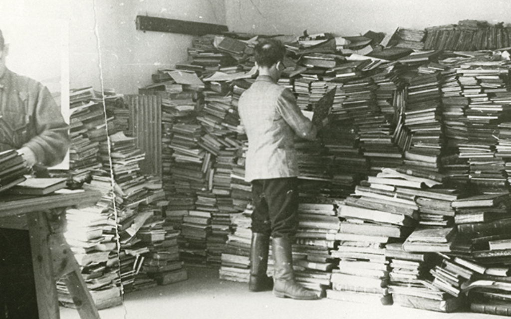 Slave laborers sort through Jewish books for the Nazis. (YIVO Institute)