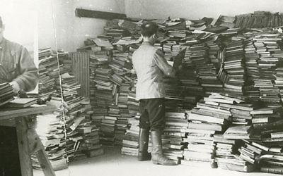 Slave laborers sort through Jewish books for the Nazis. (YIVO Institute)