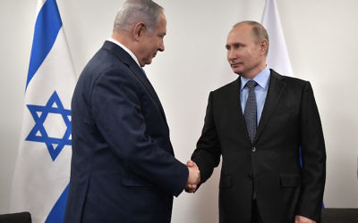 Russian President Vladimir Putin, right, greets Israeli Prime Minister Benjamin Netanyahu at the Jewish Museum and Tolerance Center in Moscow, Jan. 29, 2018. (Alexey Nikolsky/AFP/Getty Images)