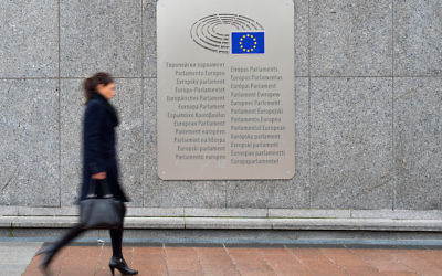 A woman walking past a European Parliament placard outside the Espace Leopold in Brussels, Belgium, Feb. 25, 2016. (Ben Pruchnie/Getty Images)