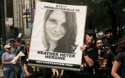 A protester in Chicago holds a sign commemorating Heather Heyer, who was killed during the Charlottesville protests in July. (Scott Olson/Getty Images)