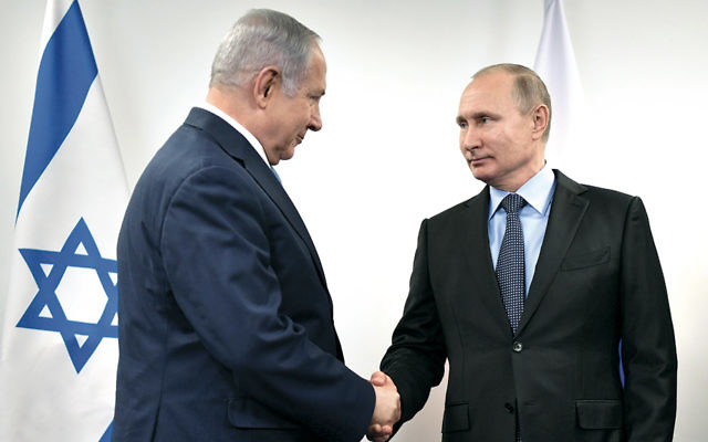 Russian President Vladimir Putin, right, greets Israeli Prime Minister Benjamin Netanyahu at the Jewish Museum and Tolerance Center in Moscow on January 29, 2018. (Alexey Nikolsky/AFP/Getty Images)