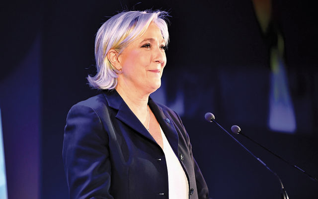 National Front leader Marine Le Pen addresses activists at the Espace Francois Mitterrand in Henin Beaumont, France, April 23, 2017. (Jeff J Mitchell/Getty Images)